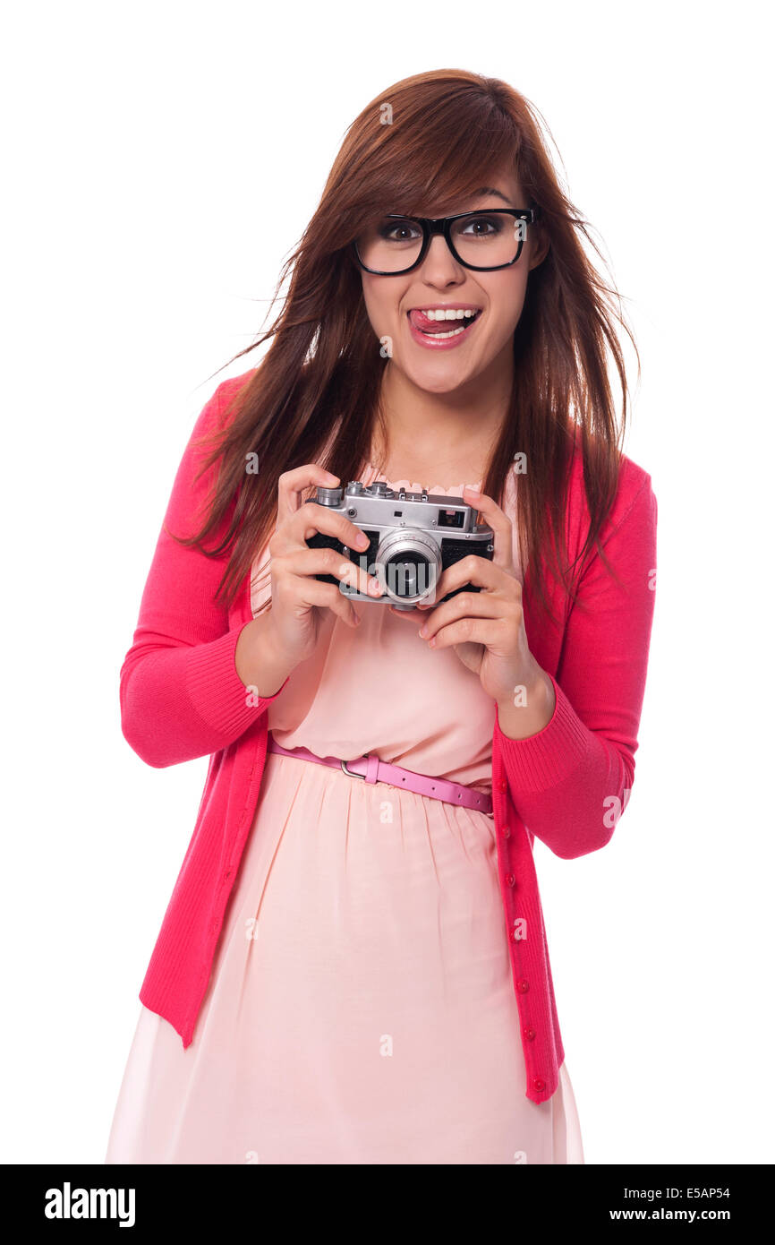 Mischievous young woman with vintage camera Debica, Poland - Stock Image