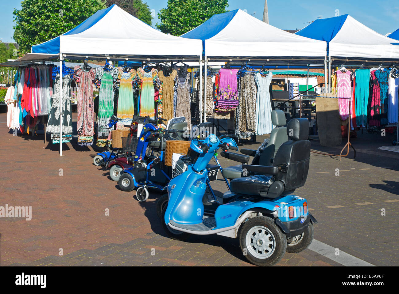 Mobility scooters on sale in Petersfield market, Hampshire, England UK - Stock Image