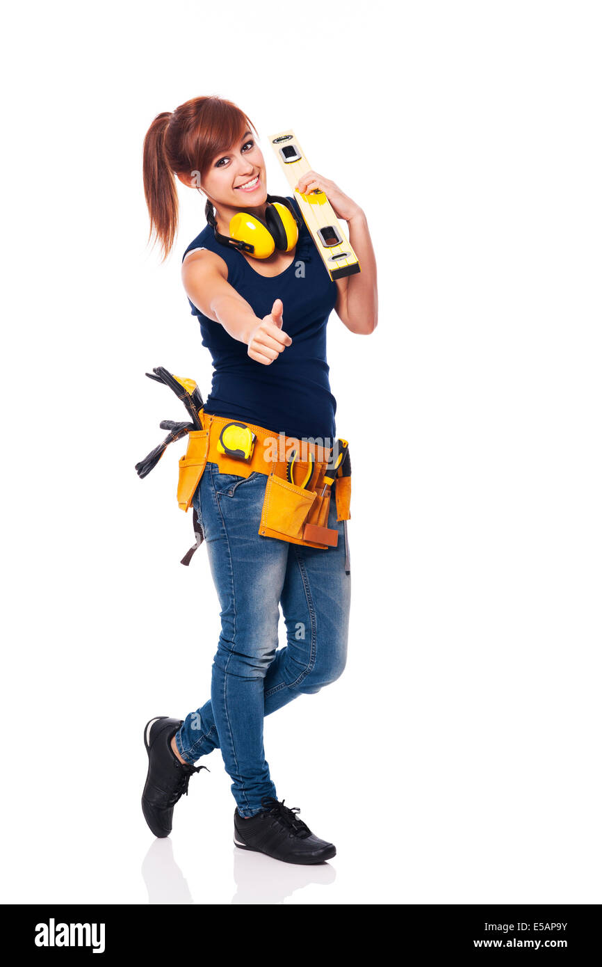 Young female construction worker showing OK sign, Debica, Poland - Stock Image