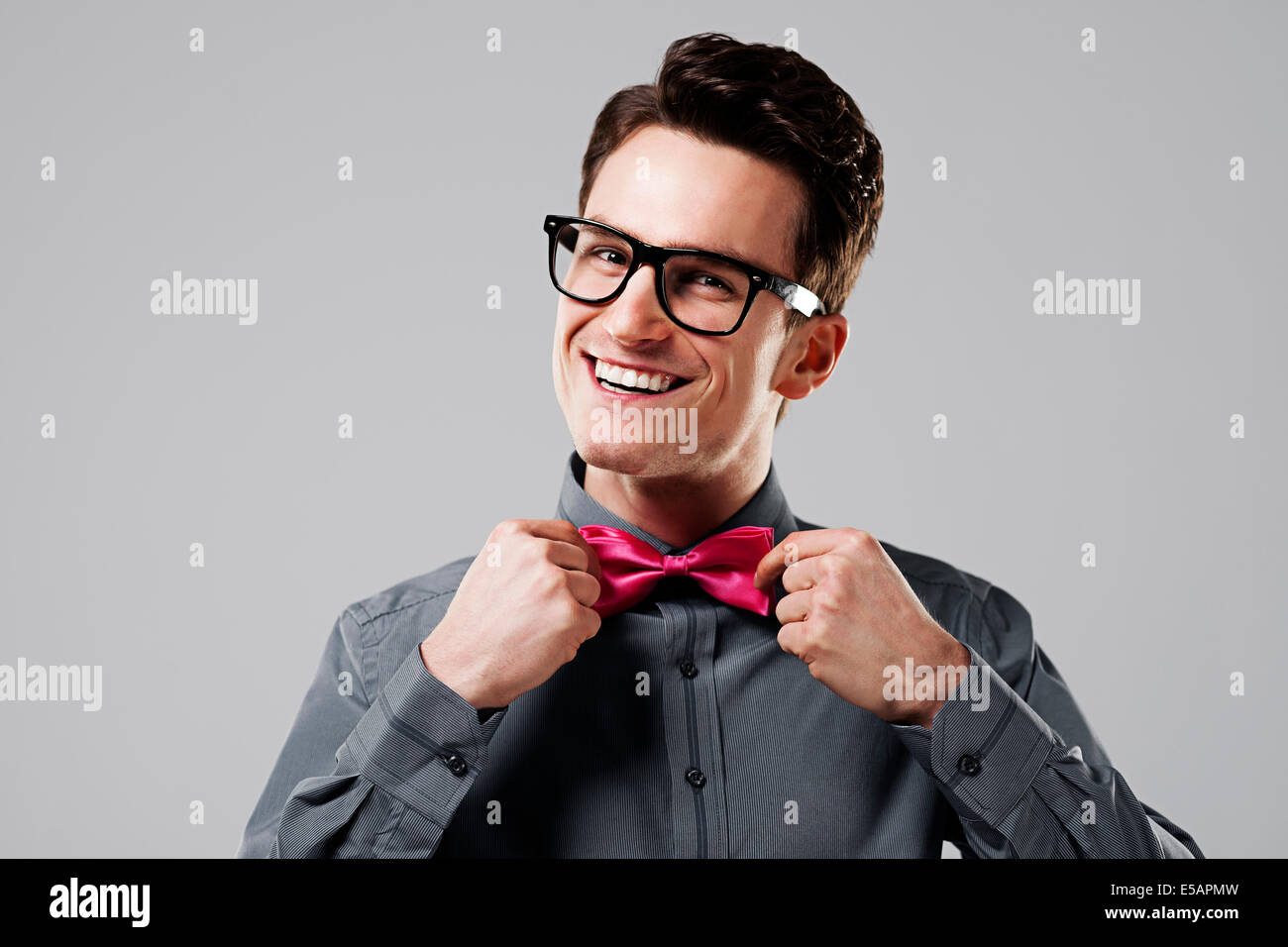 Smiling man with pink bow tie Debica, Poland - Stock Image