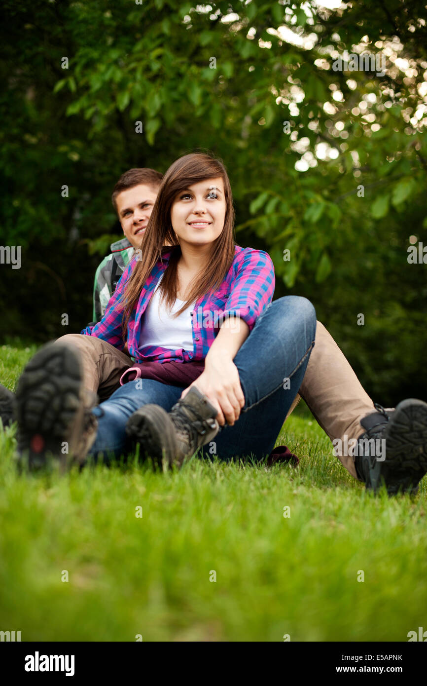 Young couple sitting on glade Debica, Poland - Stock Image