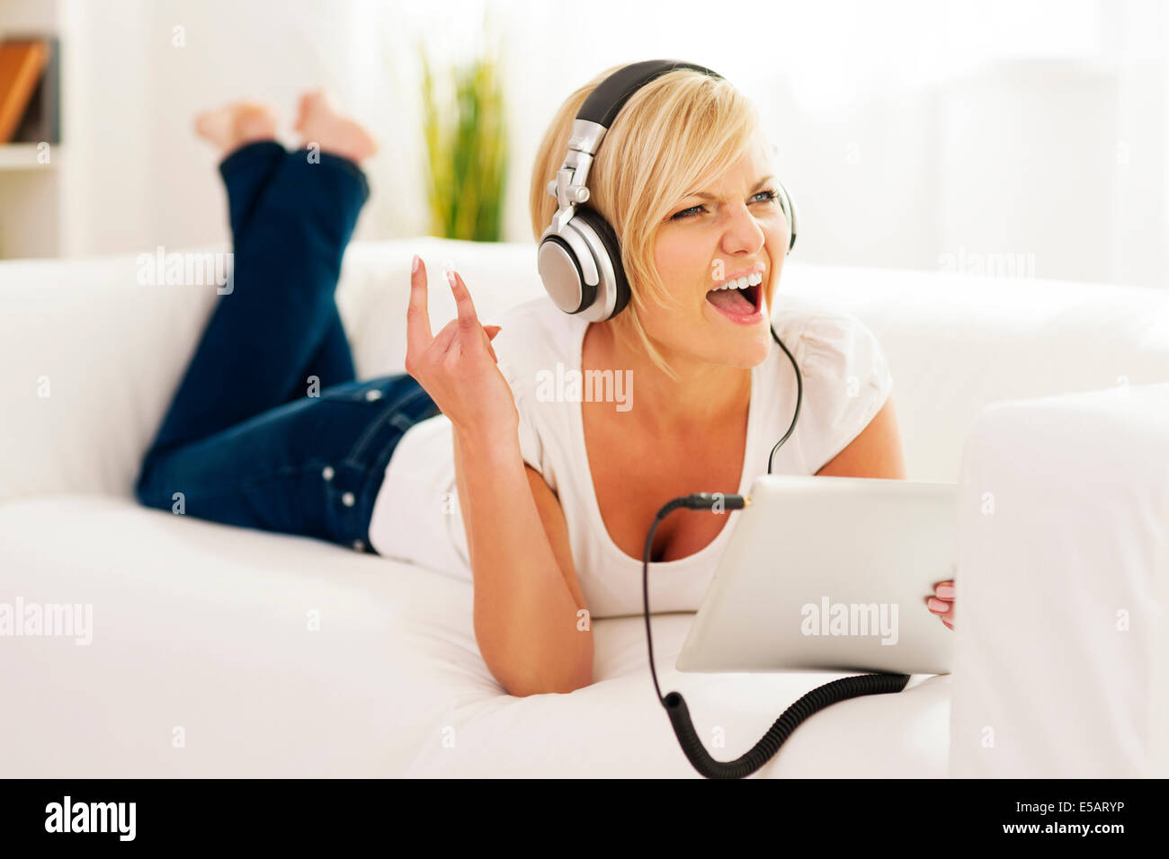 Woman listen to rock music at home Debica, Poland - Stock Image