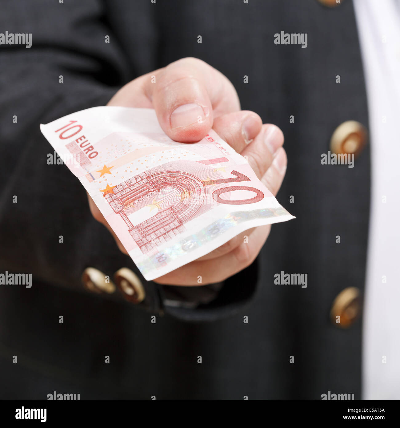 front view of ten euro banknote in businessman hand close up - Stock Image