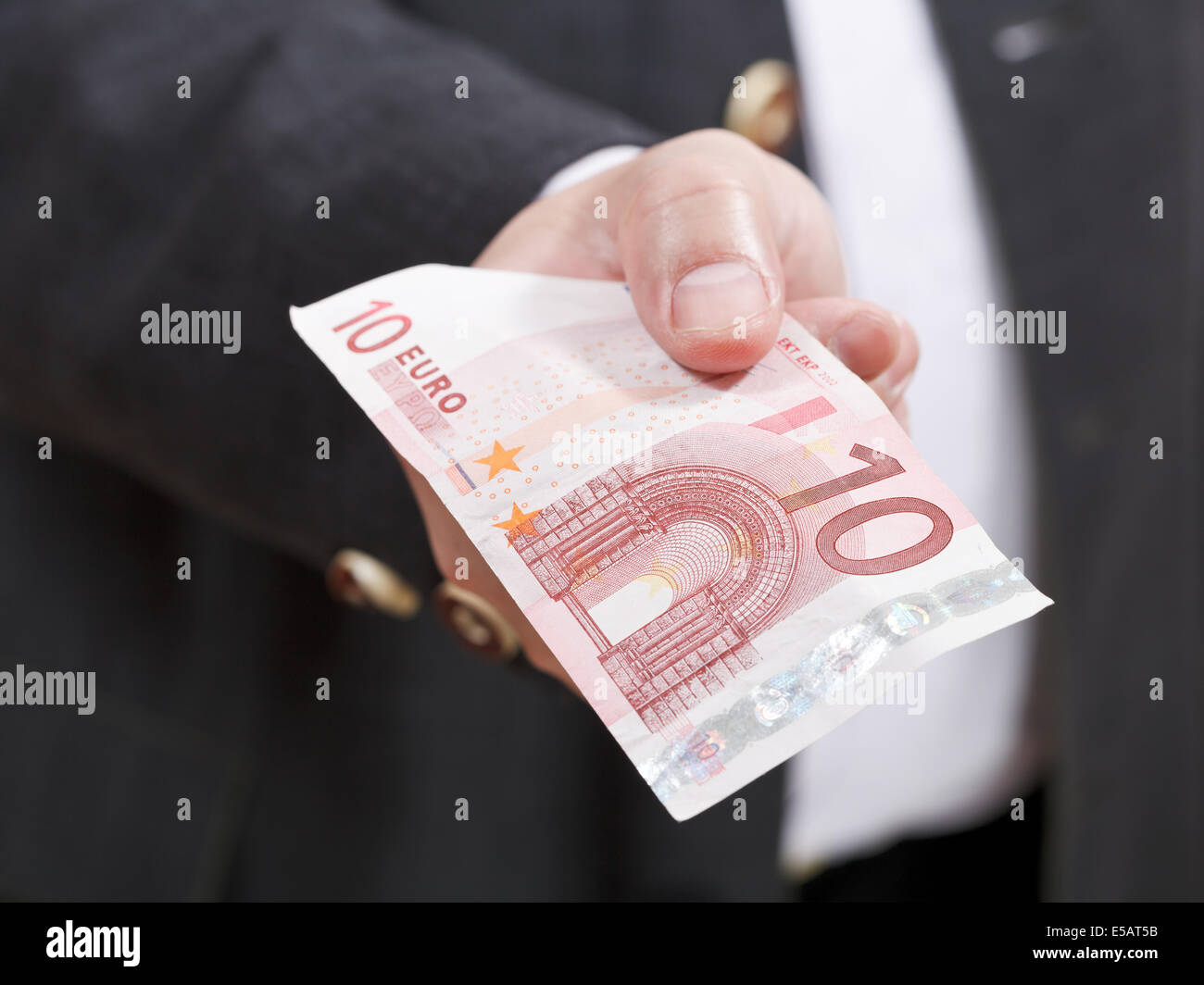 front view of ten euro banknote in male hand close up - Stock Image