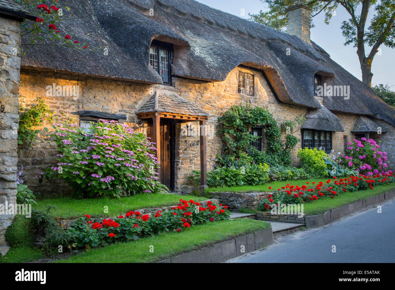Thatch roof cottage in Broad Campden, the Cotswolds, Gloucestershire, England - Stock Image