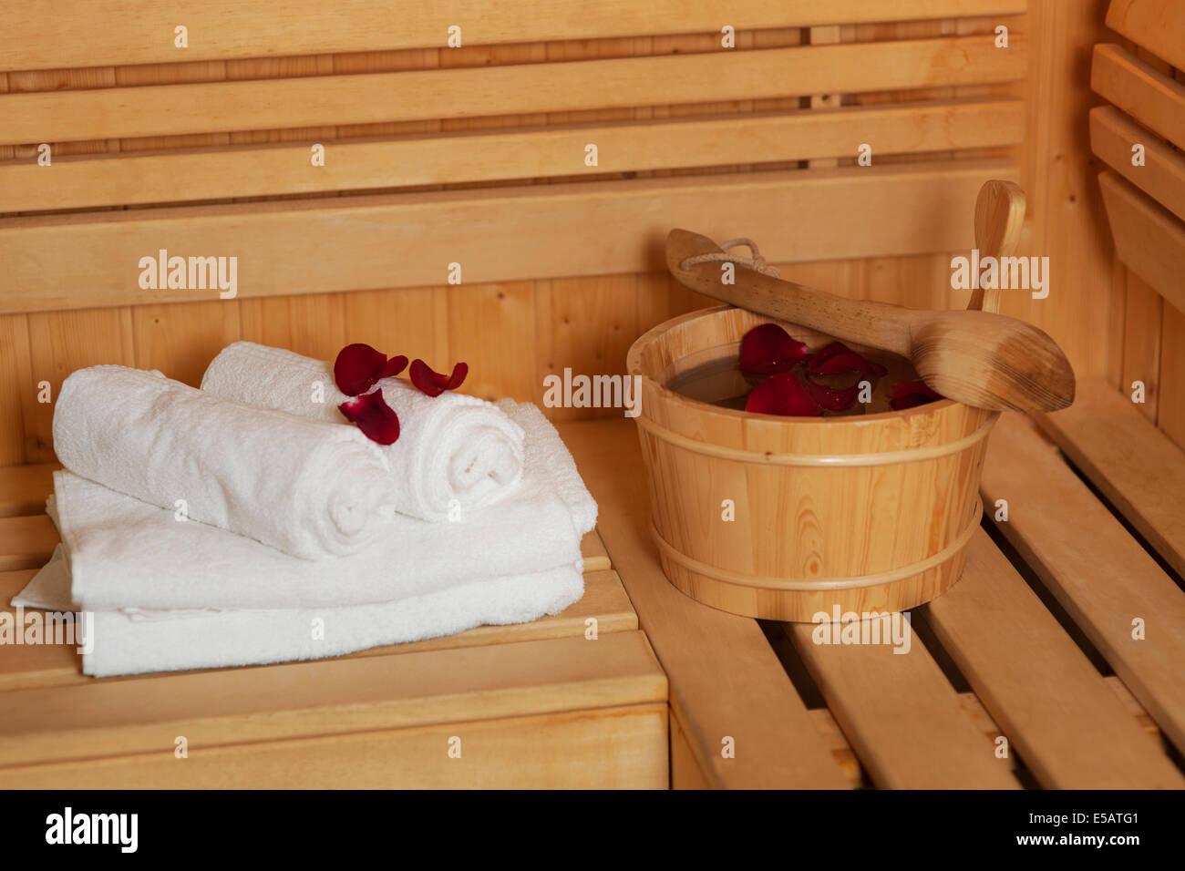 Sauna bucket with rose petals Debica, Poland - Stock Image