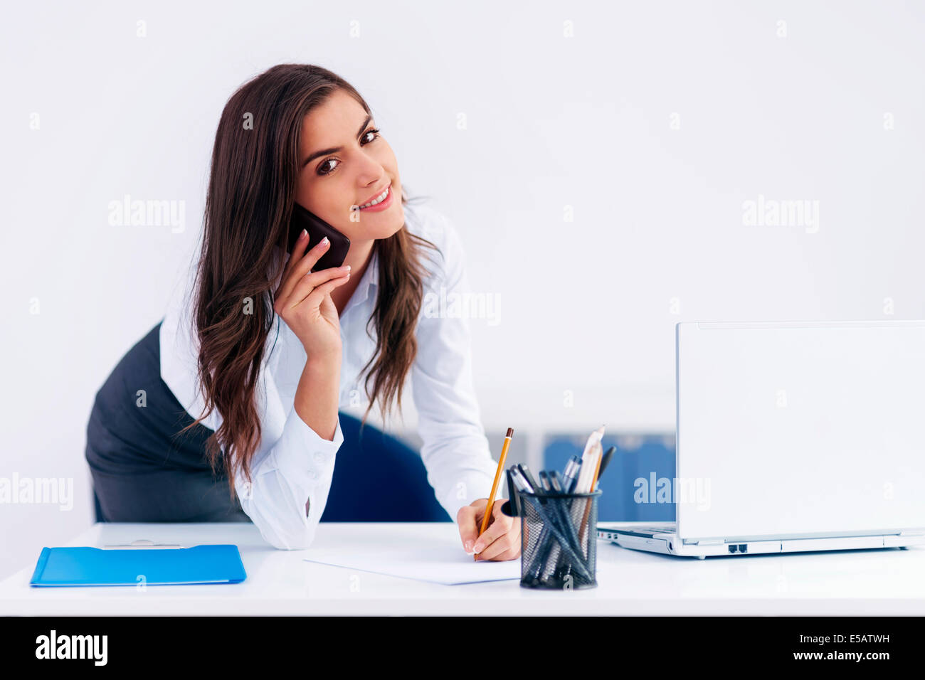 Smiling businesswoman with paperwork  Debica, Poland - Stock Image