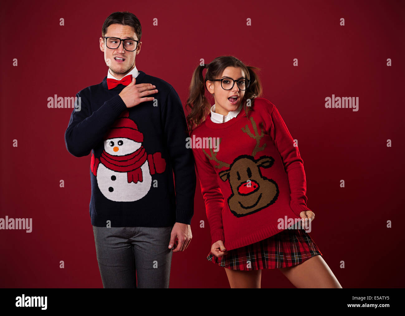 Crazy nerd couple in funny sweaters goofing around Debica, Poland - Stock Image