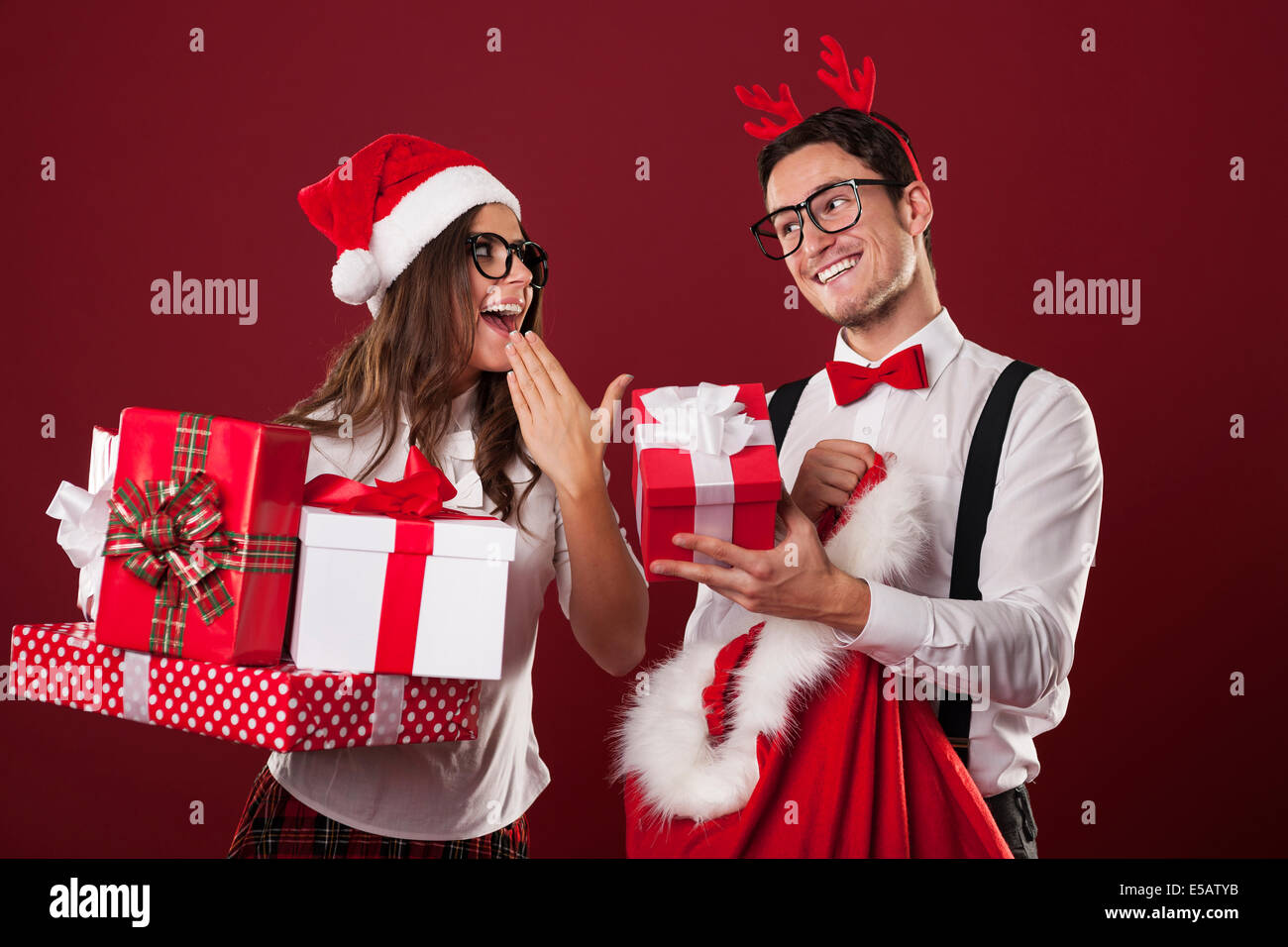 Nerd couple exchanging Christmas gifts Debica, Poland - Stock Image