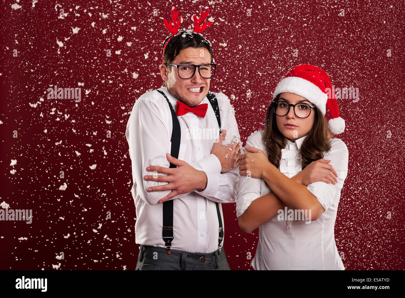 Funny couple shaking from cold weather in Christmas time  Debica, Poland - Stock Image