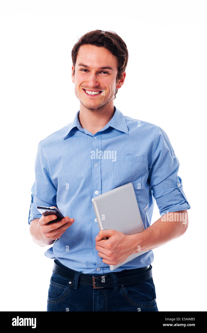Happy man holding mobile phone and digital tablet Debica, Poland - Stock Image