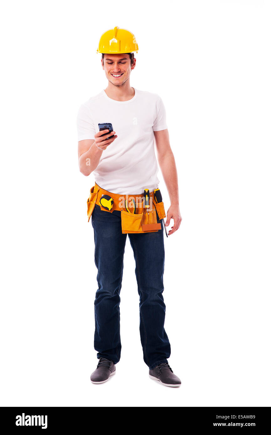Happy construction worker with smart phone Debica, Poland - Stock Image