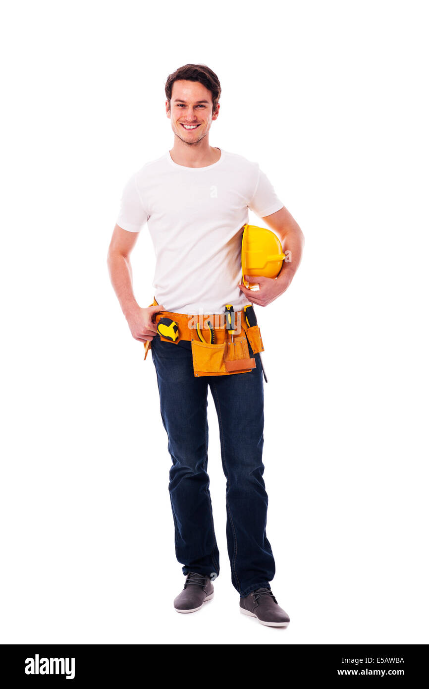 Smiling manual worker holding yellow hardhat Debica, Poland - Stock Image
