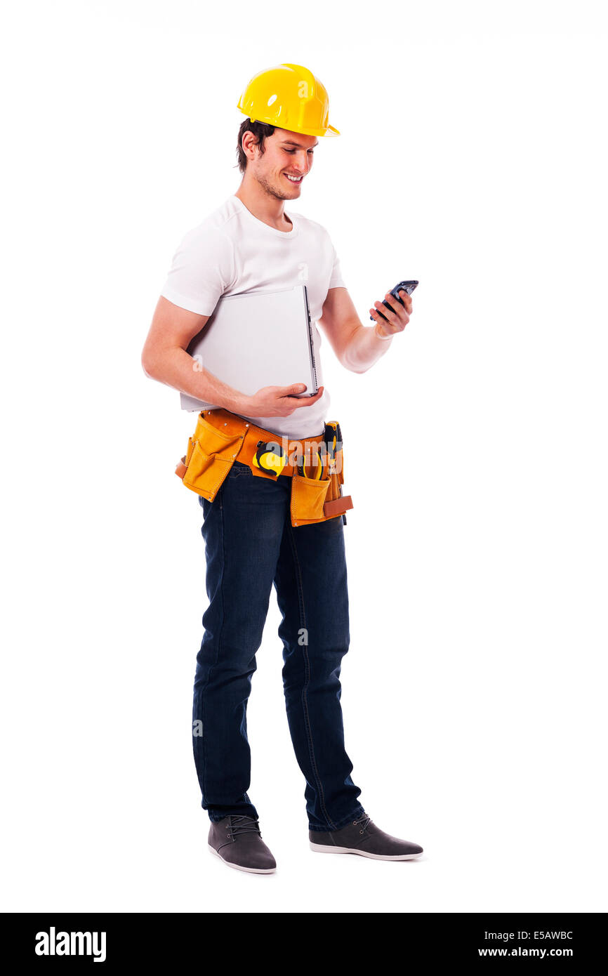 Construction worker checking something on the mobile phone Debica, Poland - Stock Image