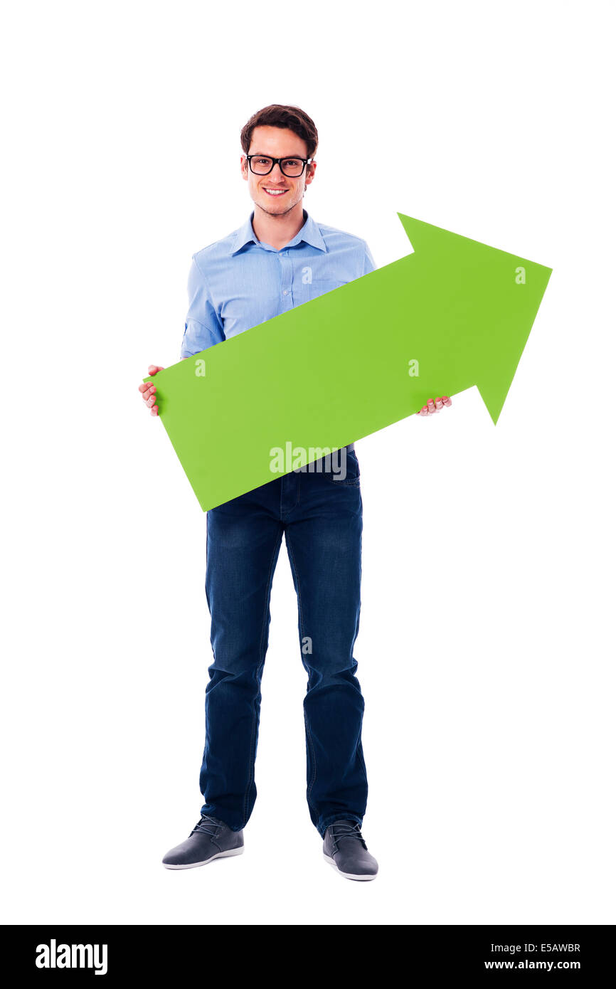 Smiling man holding green arrow Debica, Poland - Stock Image