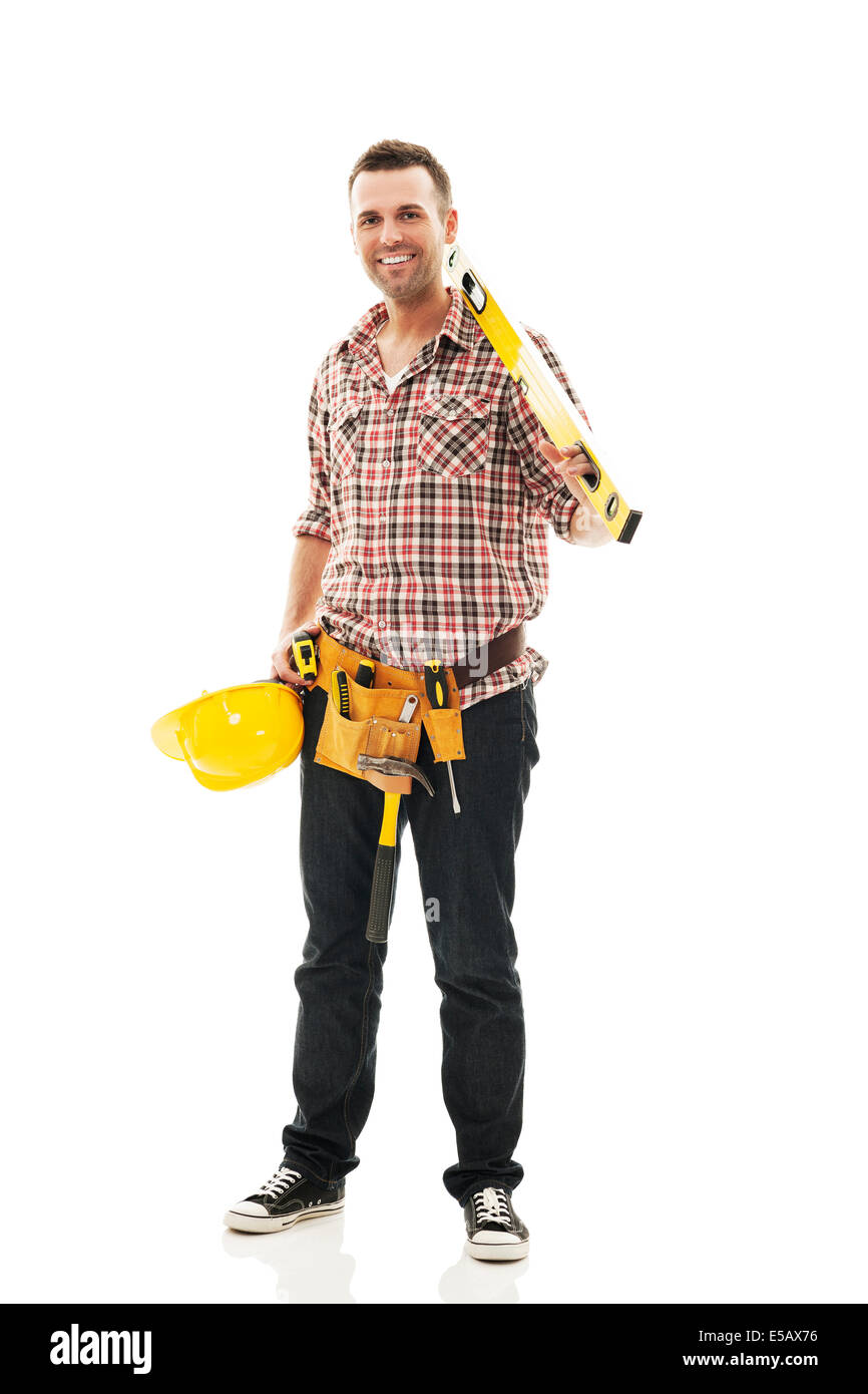 Smiling construction worker with work tool Debica, Poland - Stock Image