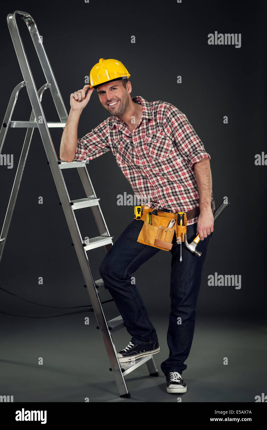 Manual worker leaning on the ladder Debica, Poland - Stock Image