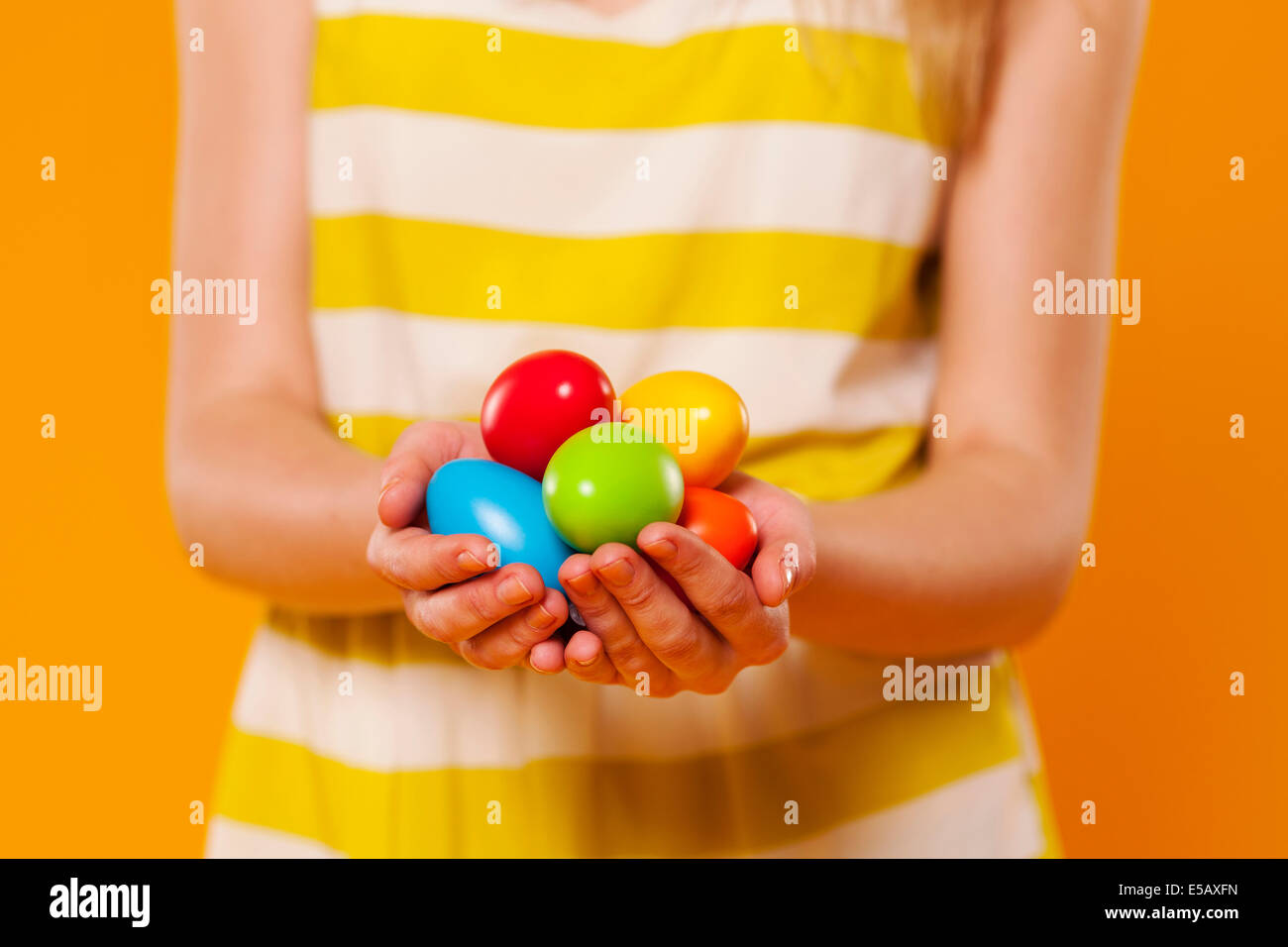 Close-up of multi colored Easter egg in hands Debica, Poland - Stock Image