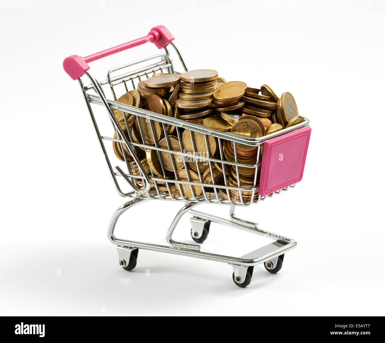 Shopping cart full of gold coins - Stock Image