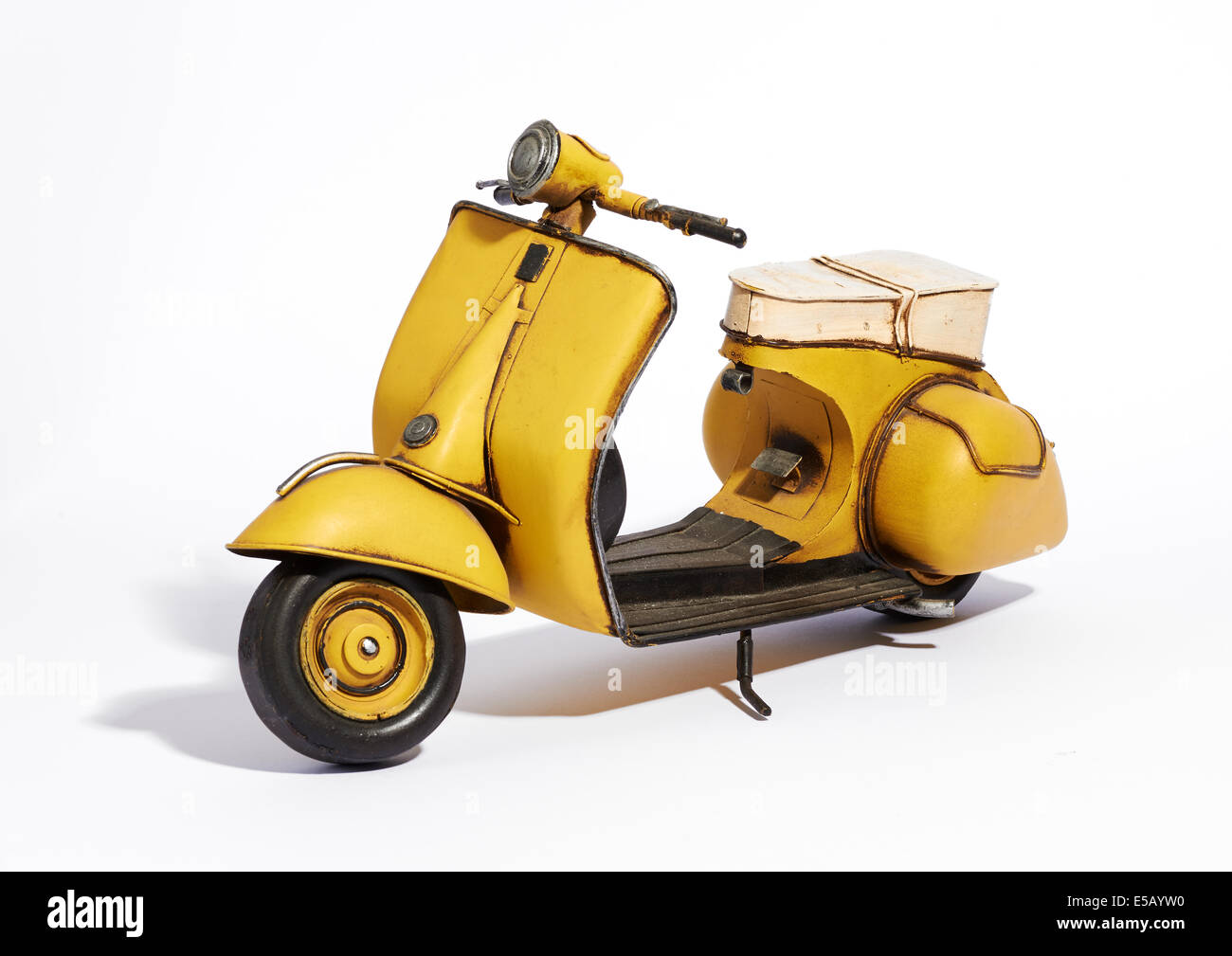 Old yellow motor scooter - Stock Image