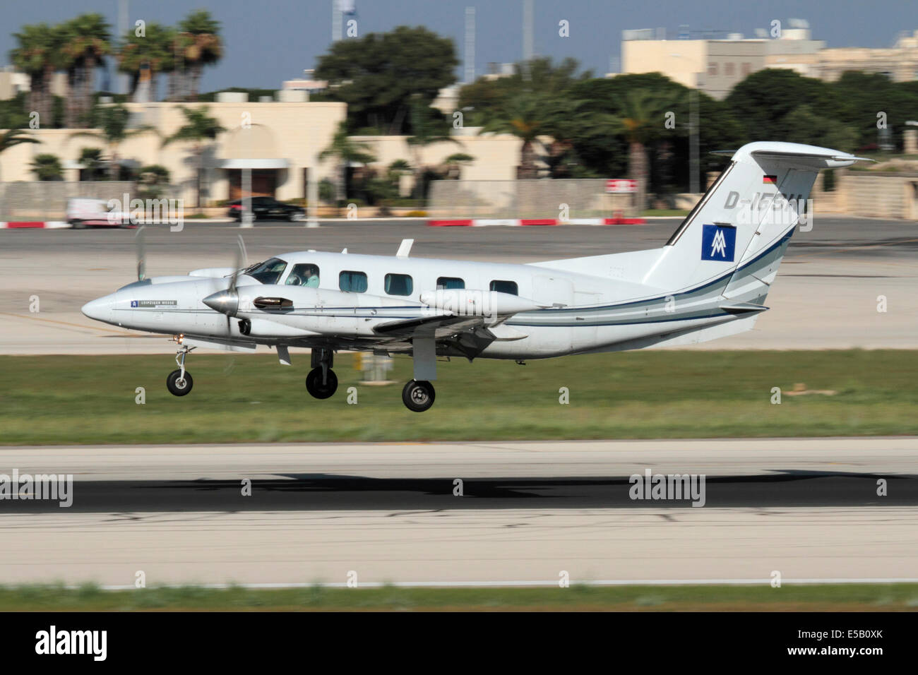Piper PA-42 Cheyenne III seven-seater aircraft operated by ProAir Aviation over the runway on arrival in Malta - Stock Image