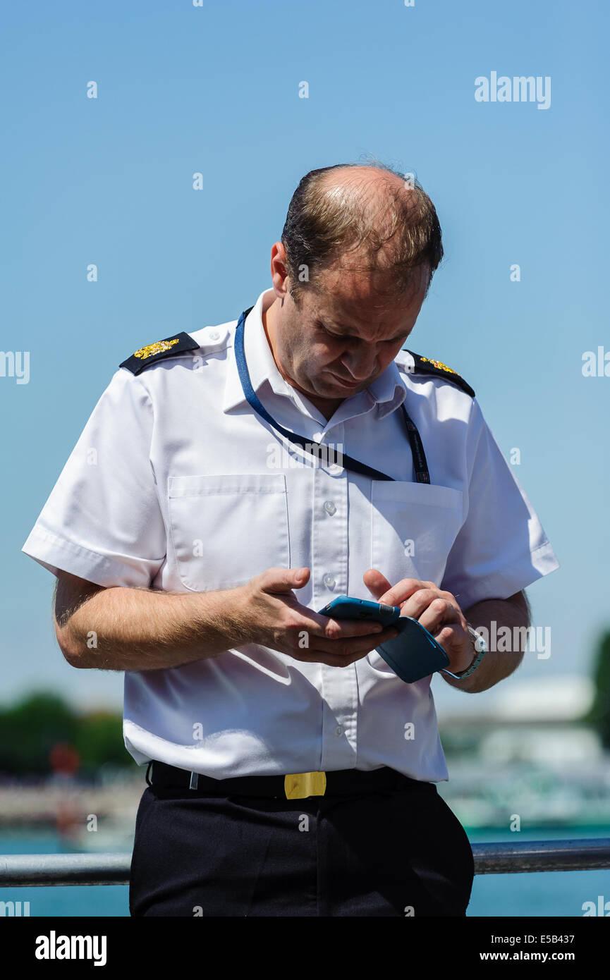 Royal Naval Serviceman using mobile phone - Stock Image