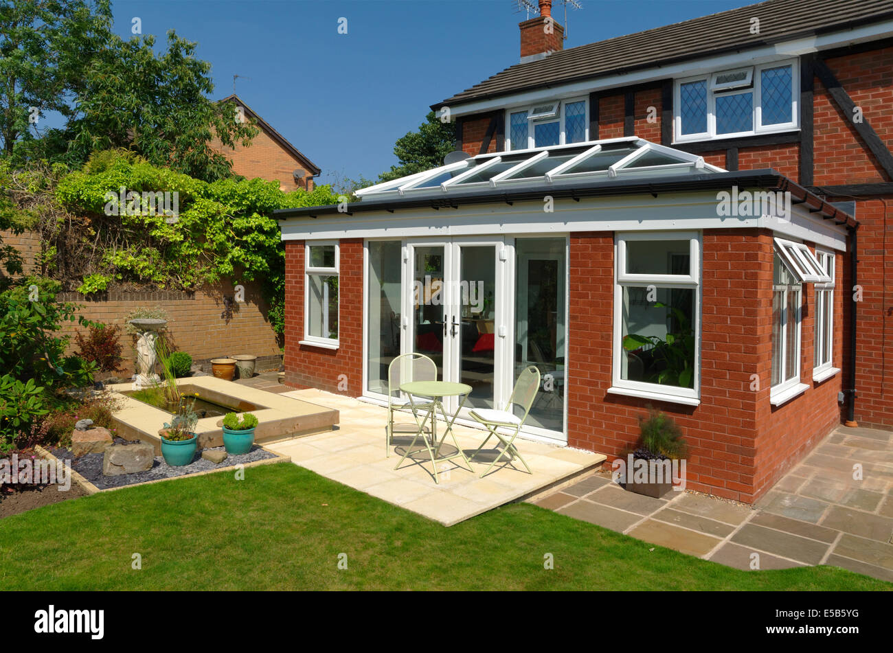 Orangery style conservatory exterior view home improvement with doors closed. - Stock Image