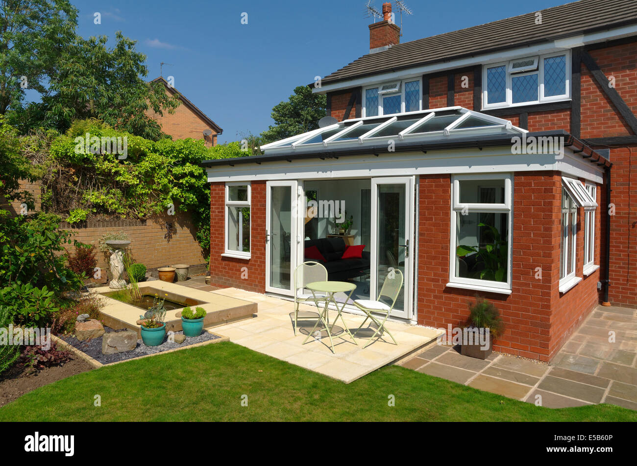 Orangery style conservatory exterior view home improvement with doors open - Stock Image