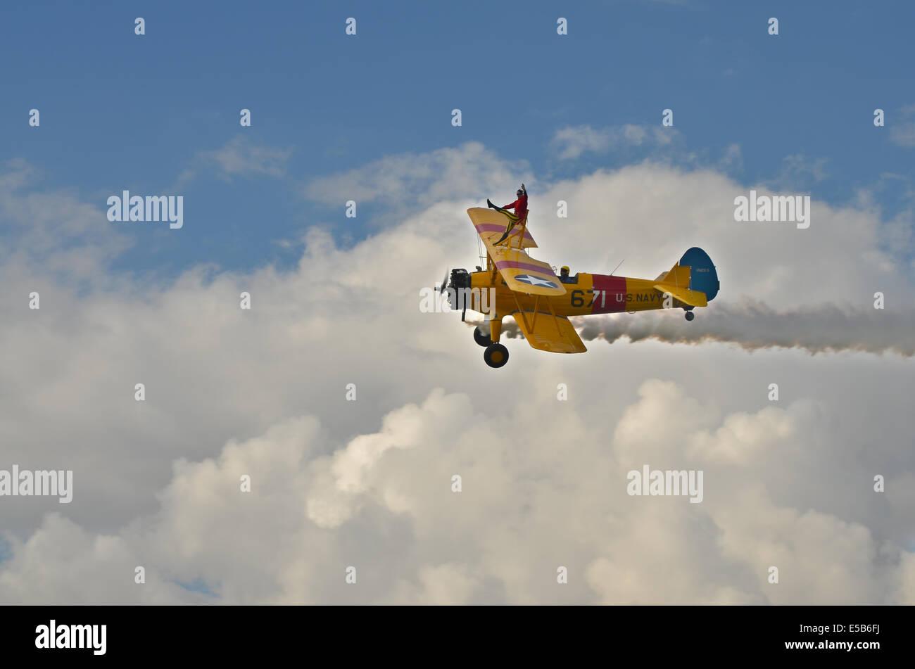 Wing walker on a yellow bi-plane Stock Photo