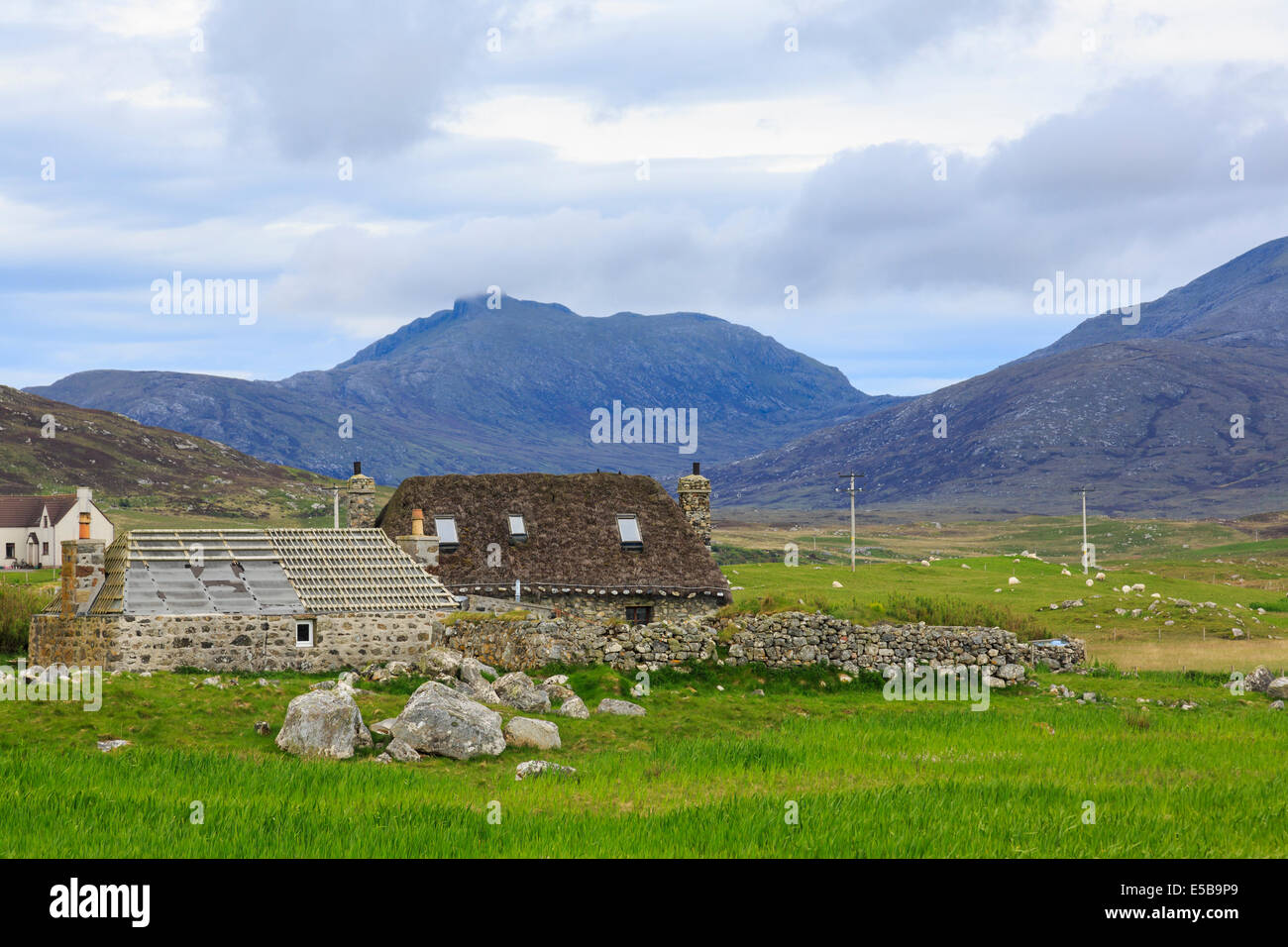 Old Blackhouses being restored for habitation as holiday homes. Howmore South Uist Outer Hebrides Western Isles - Stock Image