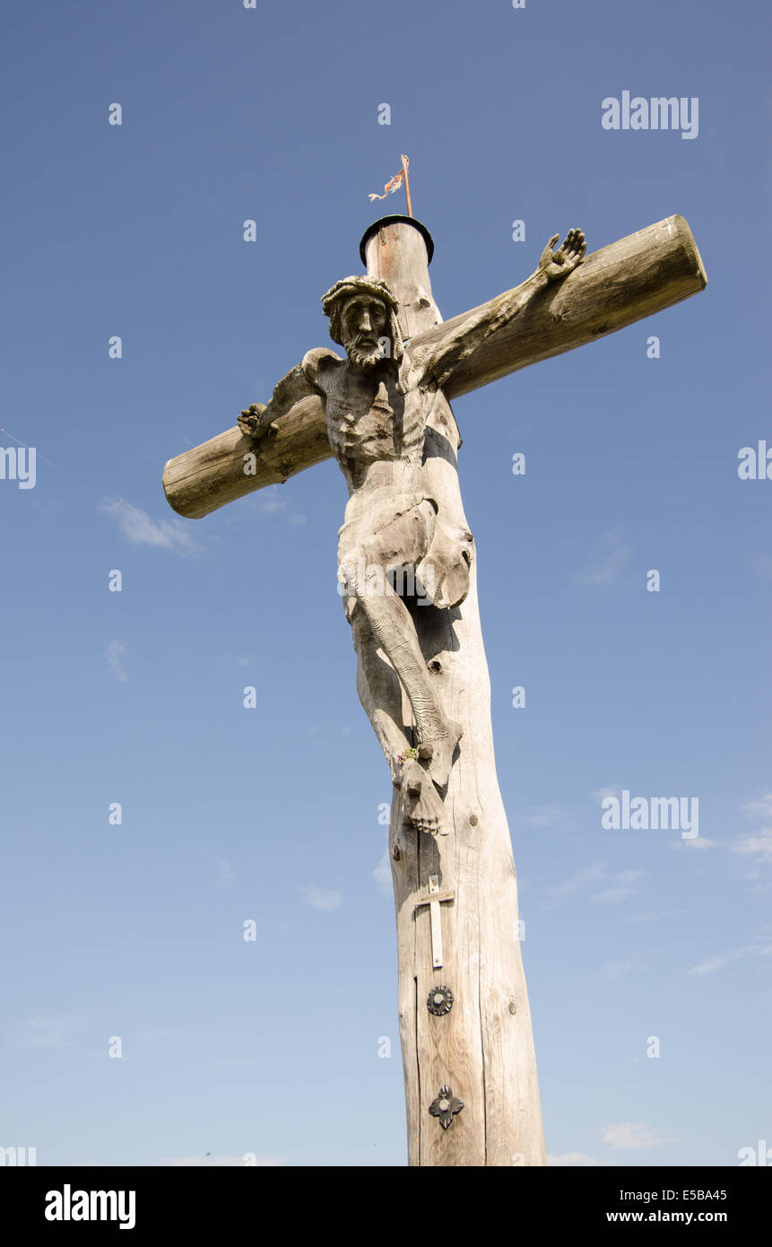 Suffer of Jesus Christ at a wooden cross on a peak in Tirol - Stock Image