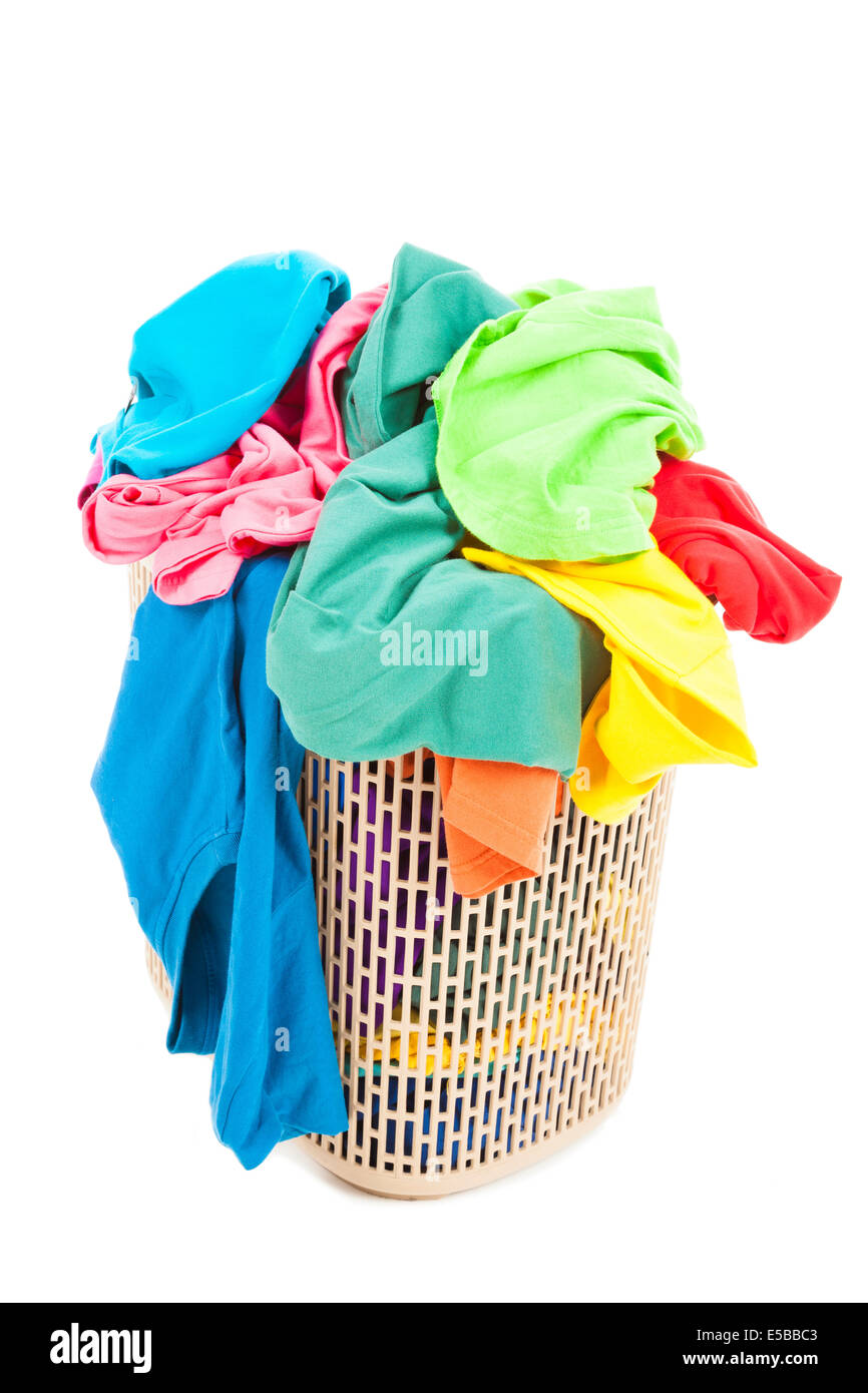 a pile of colorful and mess clothes in the basket - Stock Image