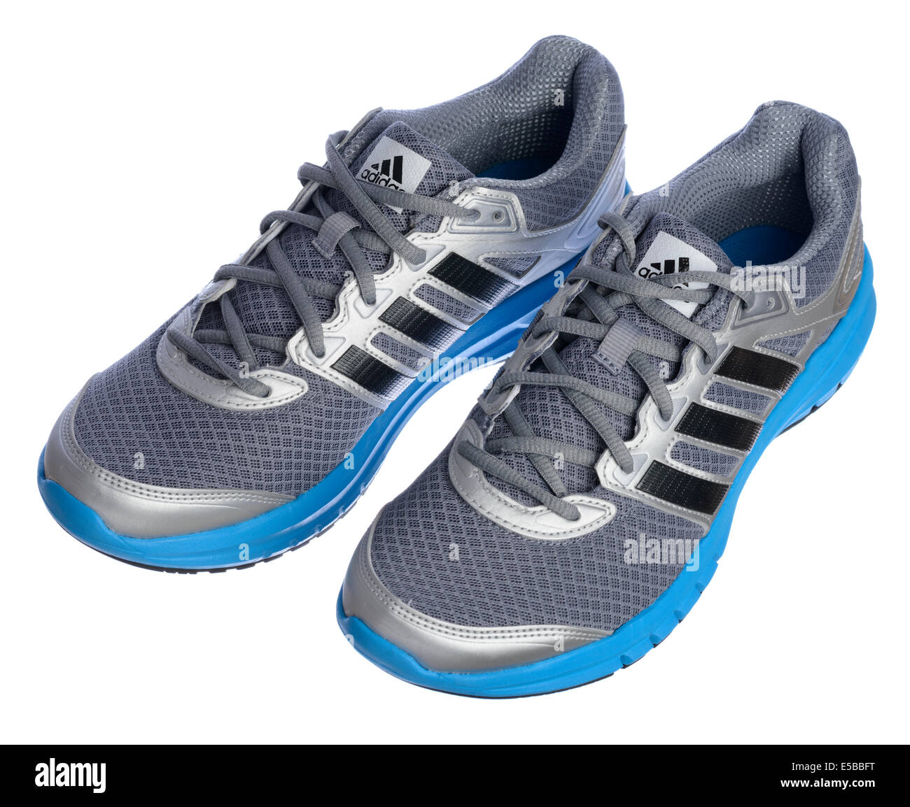 Silver and blue Adidas running shoes - Stock Image
