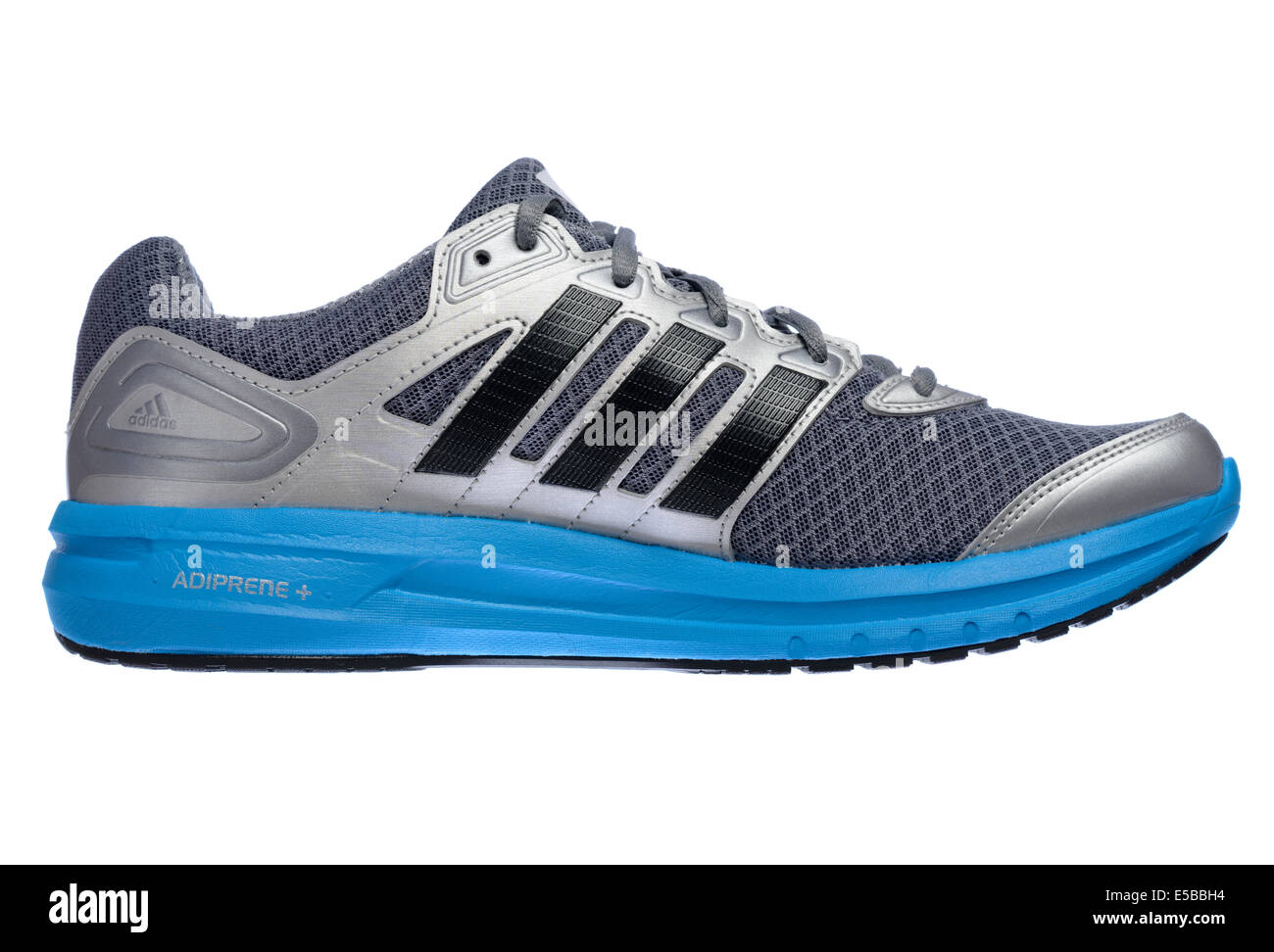Lateral view of a silver and blue Adidas running shoe cut out isolated on white background - Stock Image