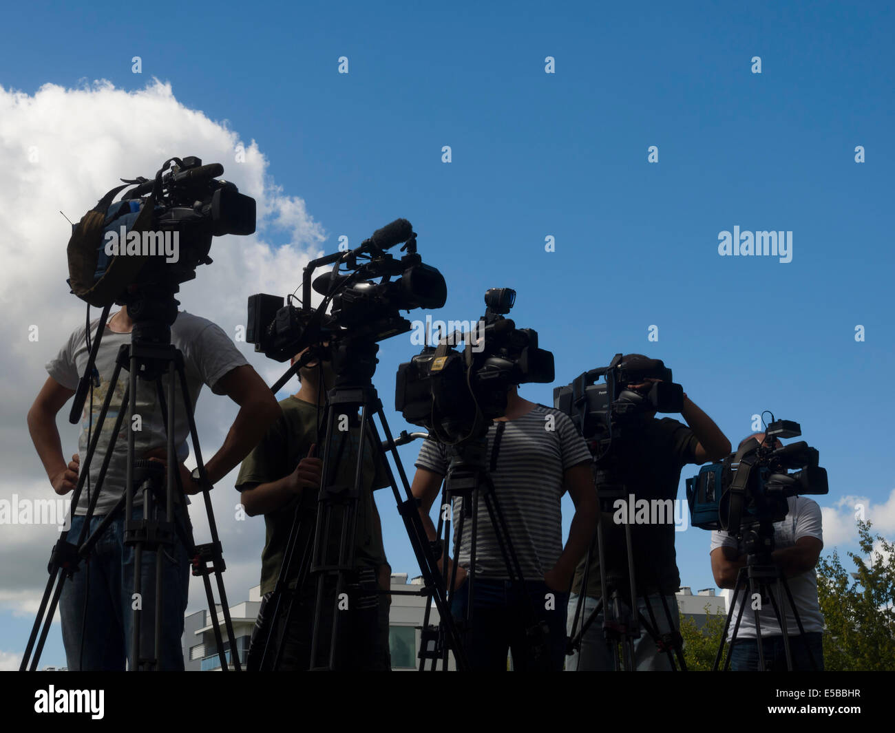 TV News cameramen covering an event - Stock Image