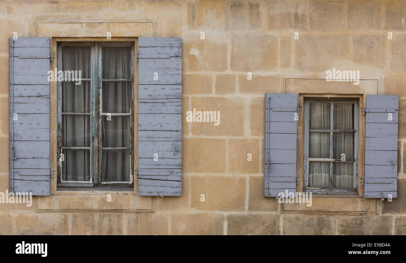 One Big Window And One Small Window With Blue Shutters Stock