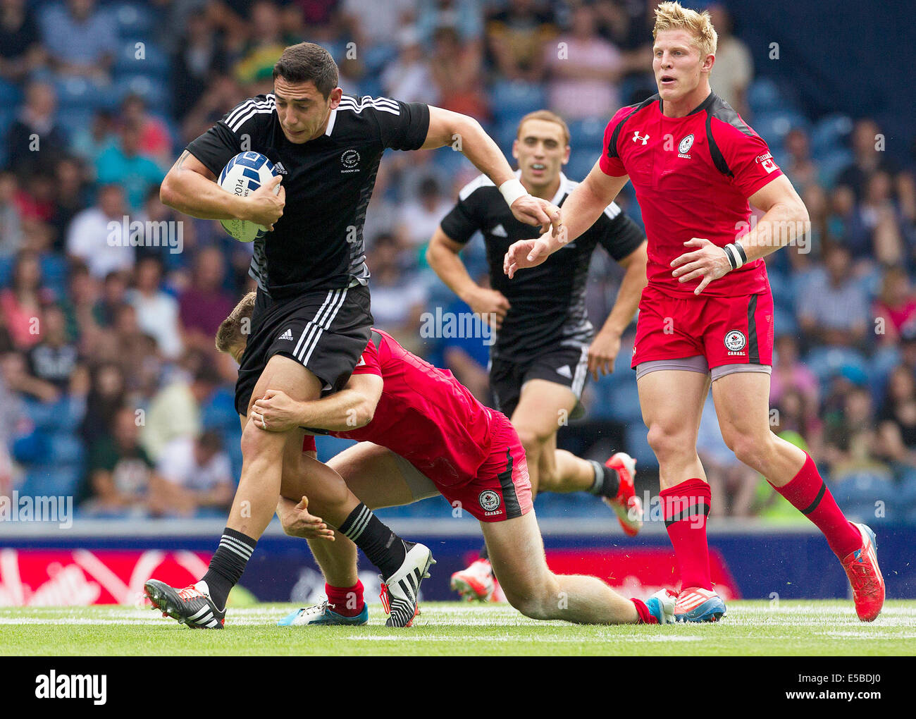 Glasgow, Scotland. 26th July, 2014. Glasgow Commonwealth Games. New Zealand's Bryce Heem's run is halted New Zealand Stock Photo