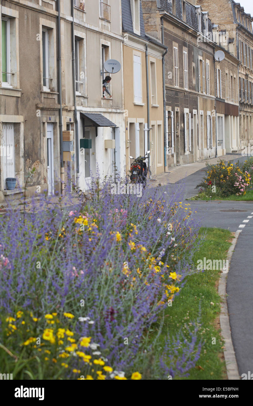 Two boys looking out window in street at Falaise, Calvados, Normandy  in July Stock Photo
