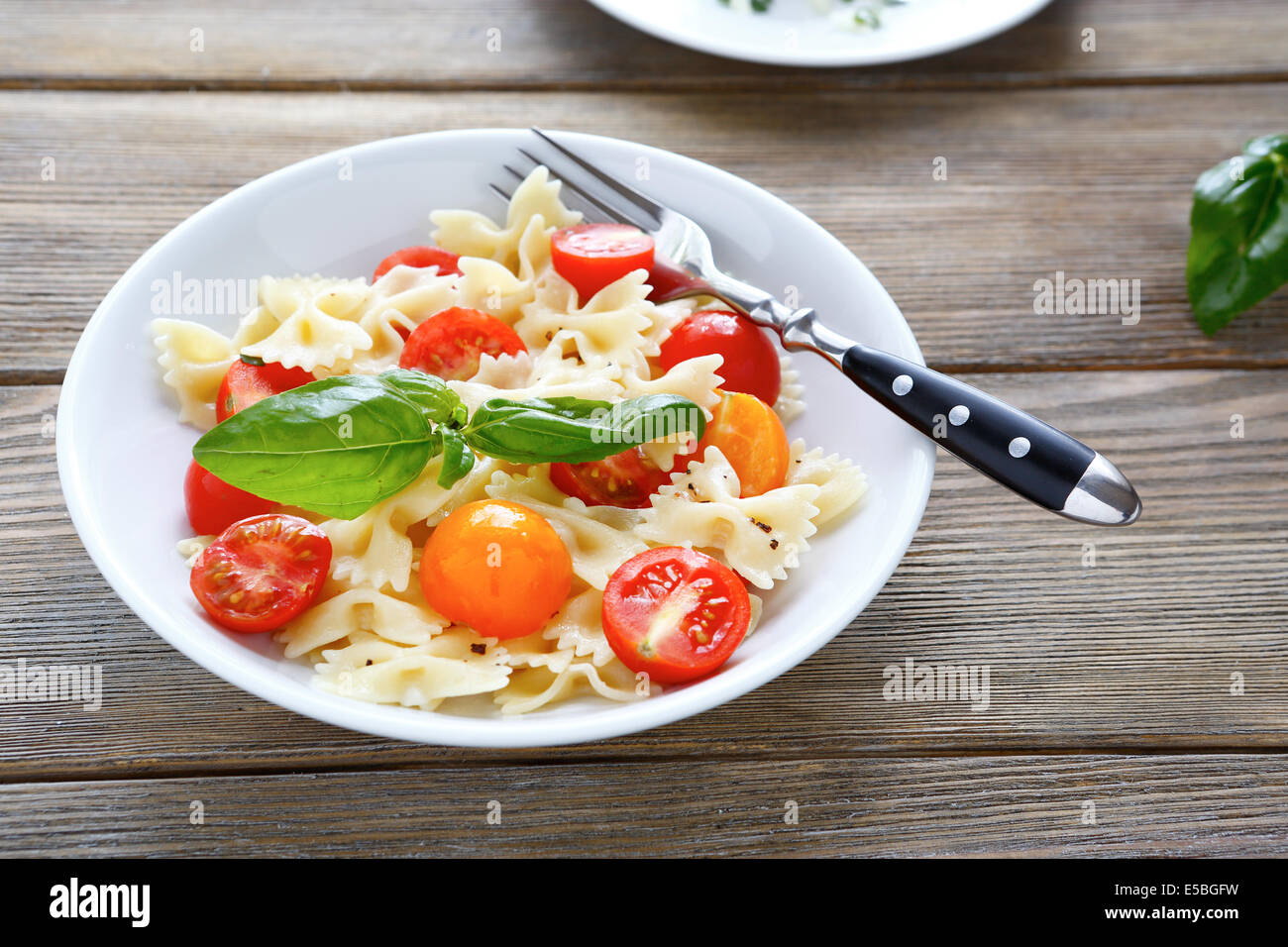 pasta with cherry tomatoes, food - Stock Image
