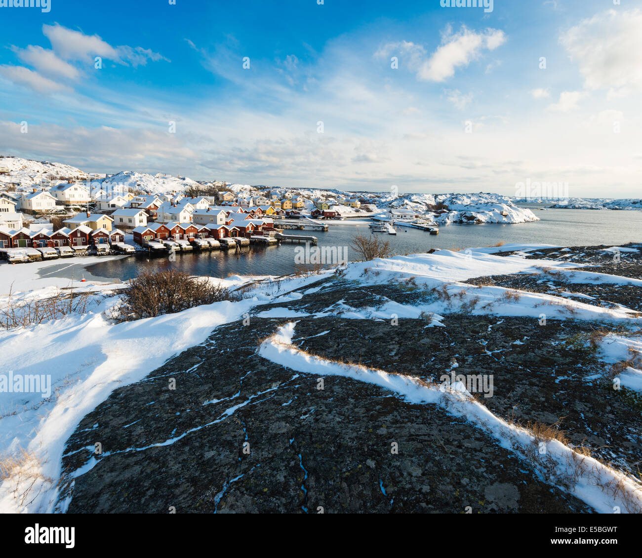 Houses at the coast in winter season, Sweden. - Stock Image