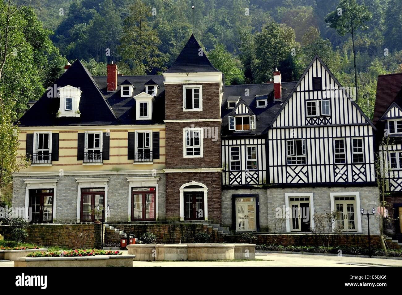 BAI LU TOWN, CHINA: Handsome French-inspired half-timbered and stucco houses line a village square  * Stock Photo