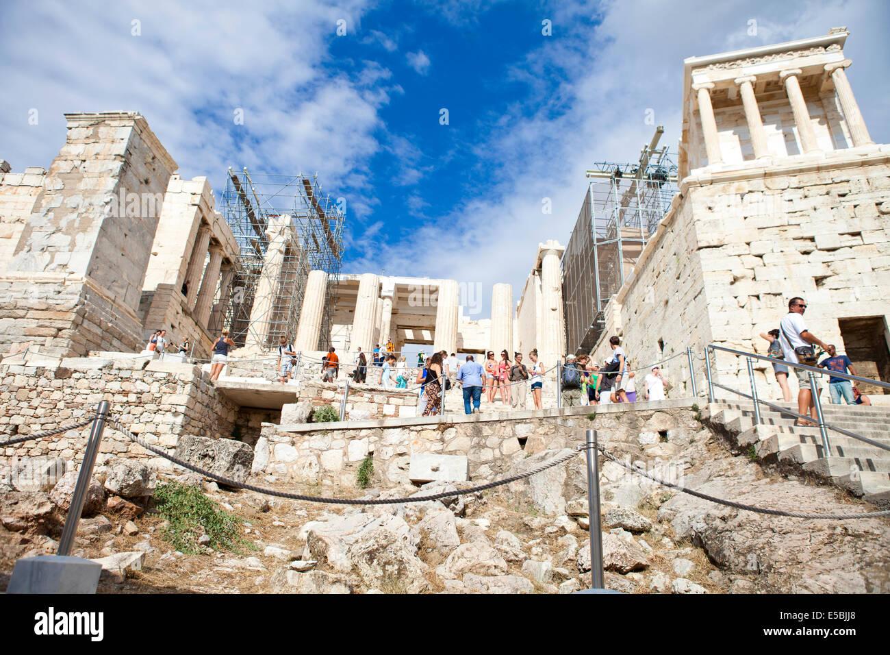 Acropolis of Athens, Propylaea as tourists entering the Parthenon - Stock Image
