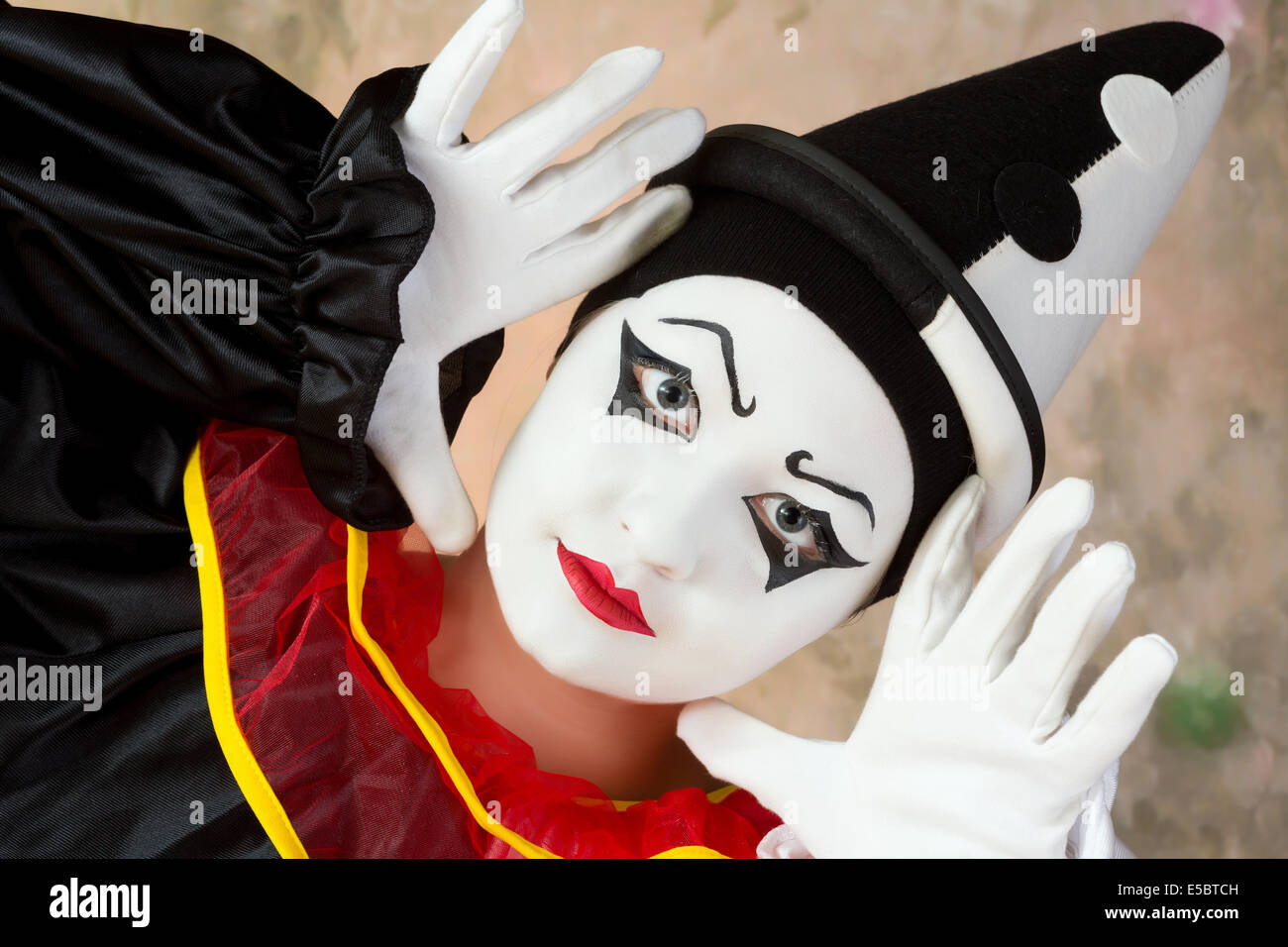 Female mime artist in pierrot clown disguise - Stock Image