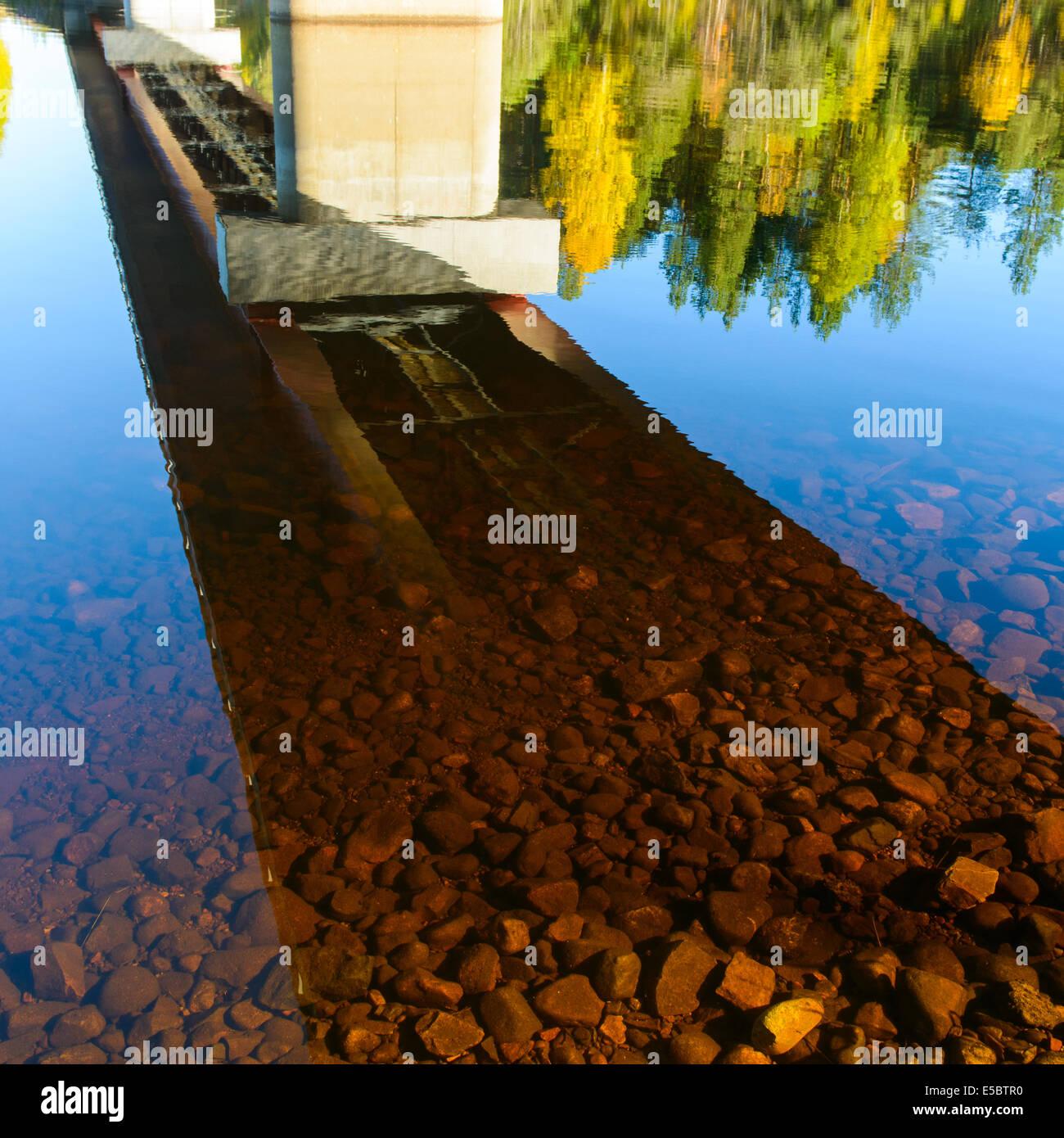 Reflection of road bridge on river, Sweden - Stock Image