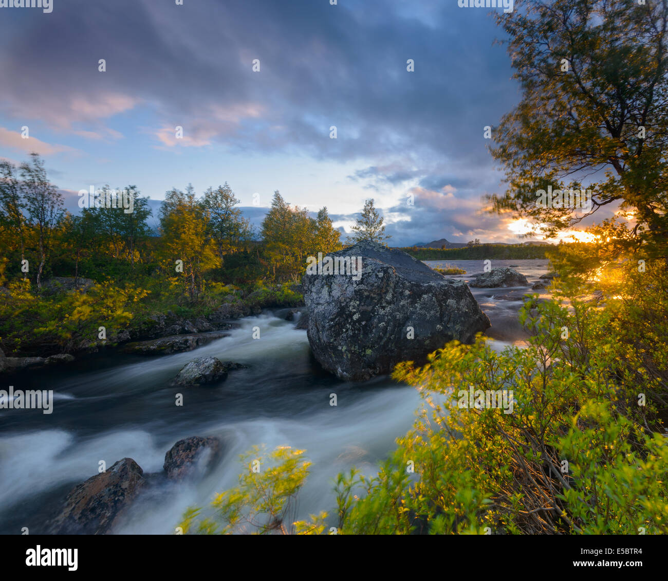 Rapid river during sunset, Dalarna, Sweden - Stock Image