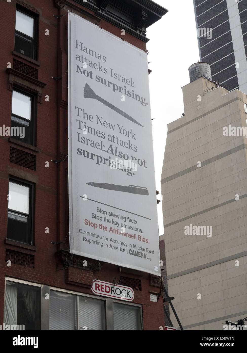 USA: NYC, NY. Sign on building across from The New York Times newspaper protests its alleged Anti-Israel bias, 2014. - Stock Image