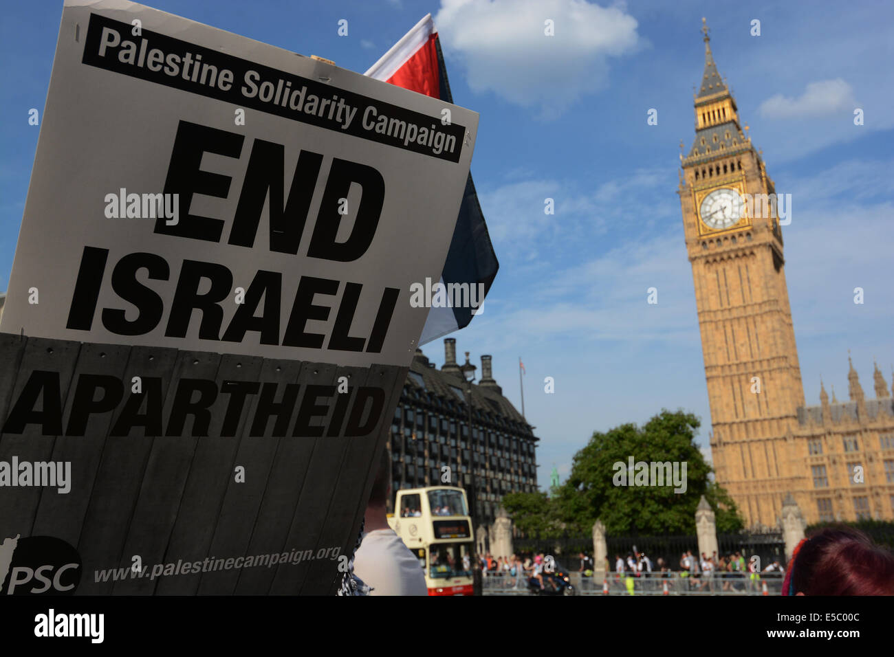 London, UK. 26th July, 2014. Protesters listen to speakiers after the March For Gaza, Saturday, July 26, 2014, at Stock Photo