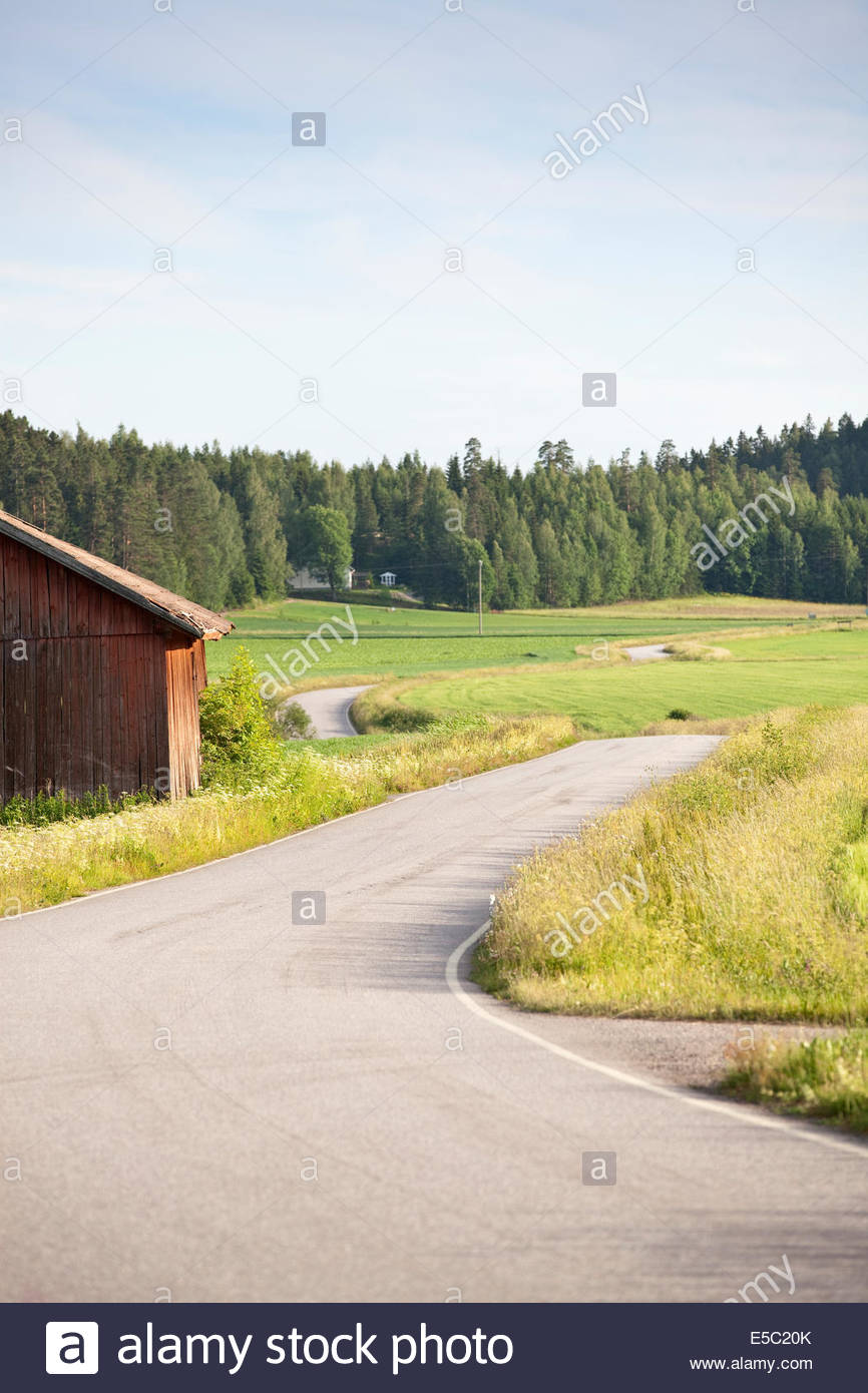 Winding road in the country - Stock Image