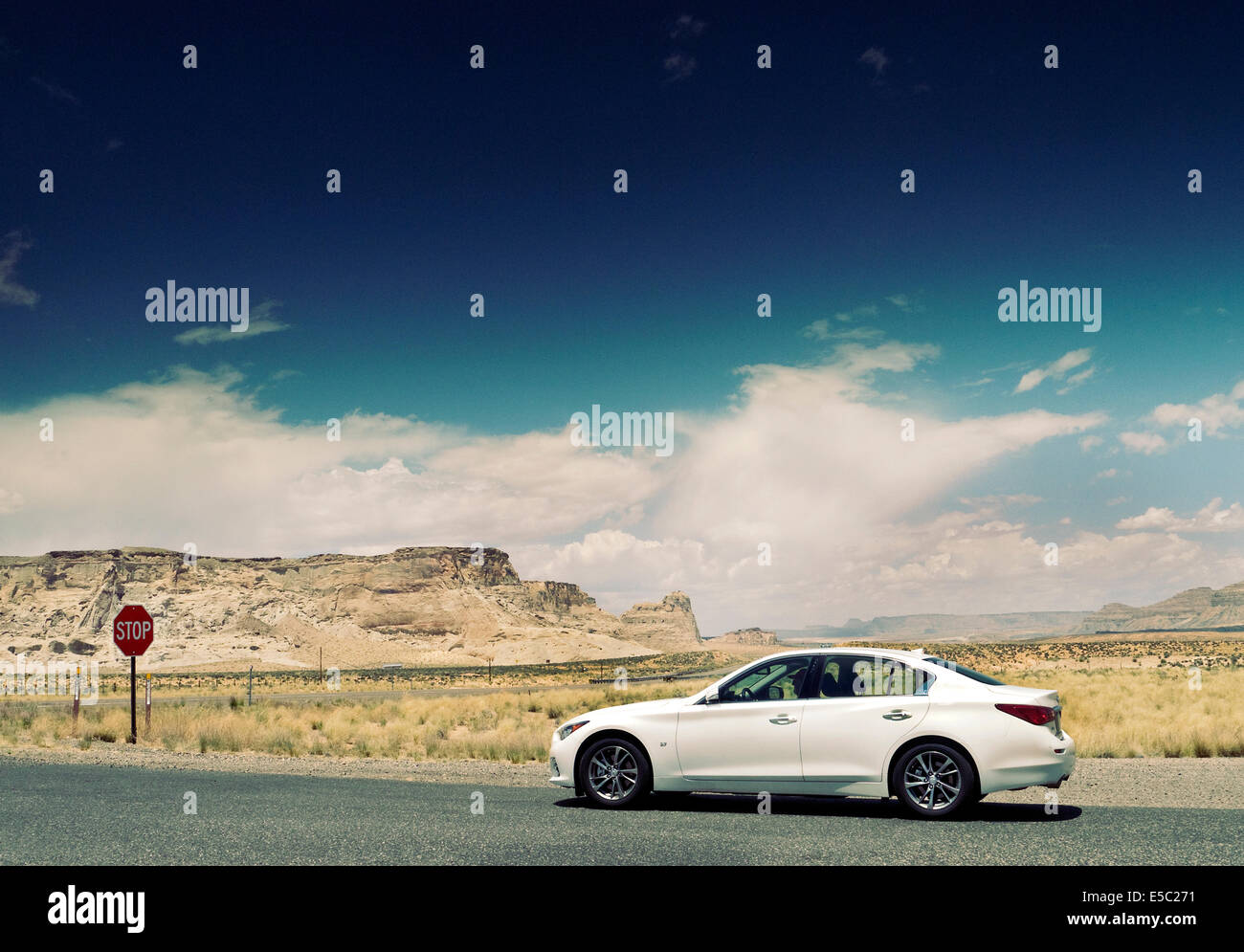 Infiniti Q50 on a desert road near lake Powell Arizona USA - Stock Image