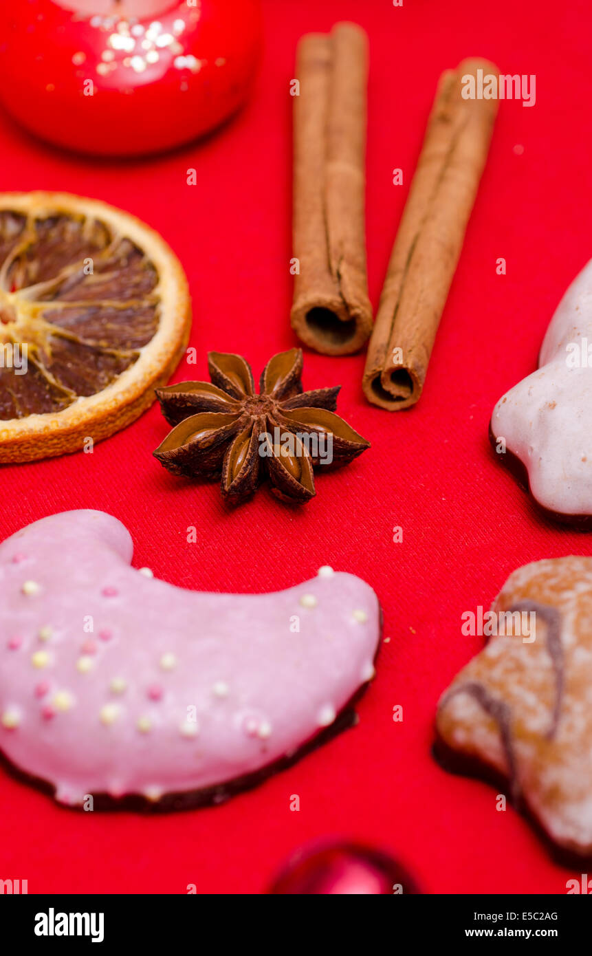 Star Anise And Christmas Cookies On A Red Background Stock Photo